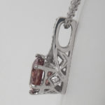 side view of white gold pink zircon and diamond pendant