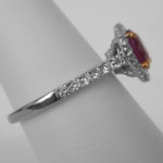 side view of white gold ruby and diamond ring