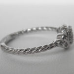 side view of white gold diamond cluster ring