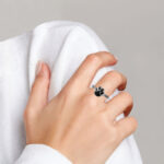 sterling silver paw print ring on finger