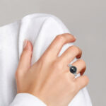 white gold Tahitian pearl and diamond ring on finger