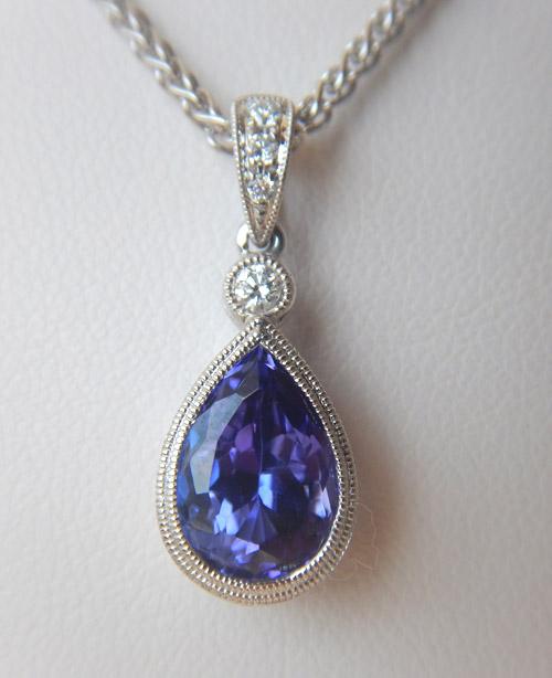 tanzanite and diamond pendant in white gold setting
