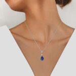 white gold tanzanite and diamond pendant on model