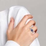 tanzanite and diamond halo ring on finger