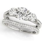 three stone diamond engagement ring with matching wedding band