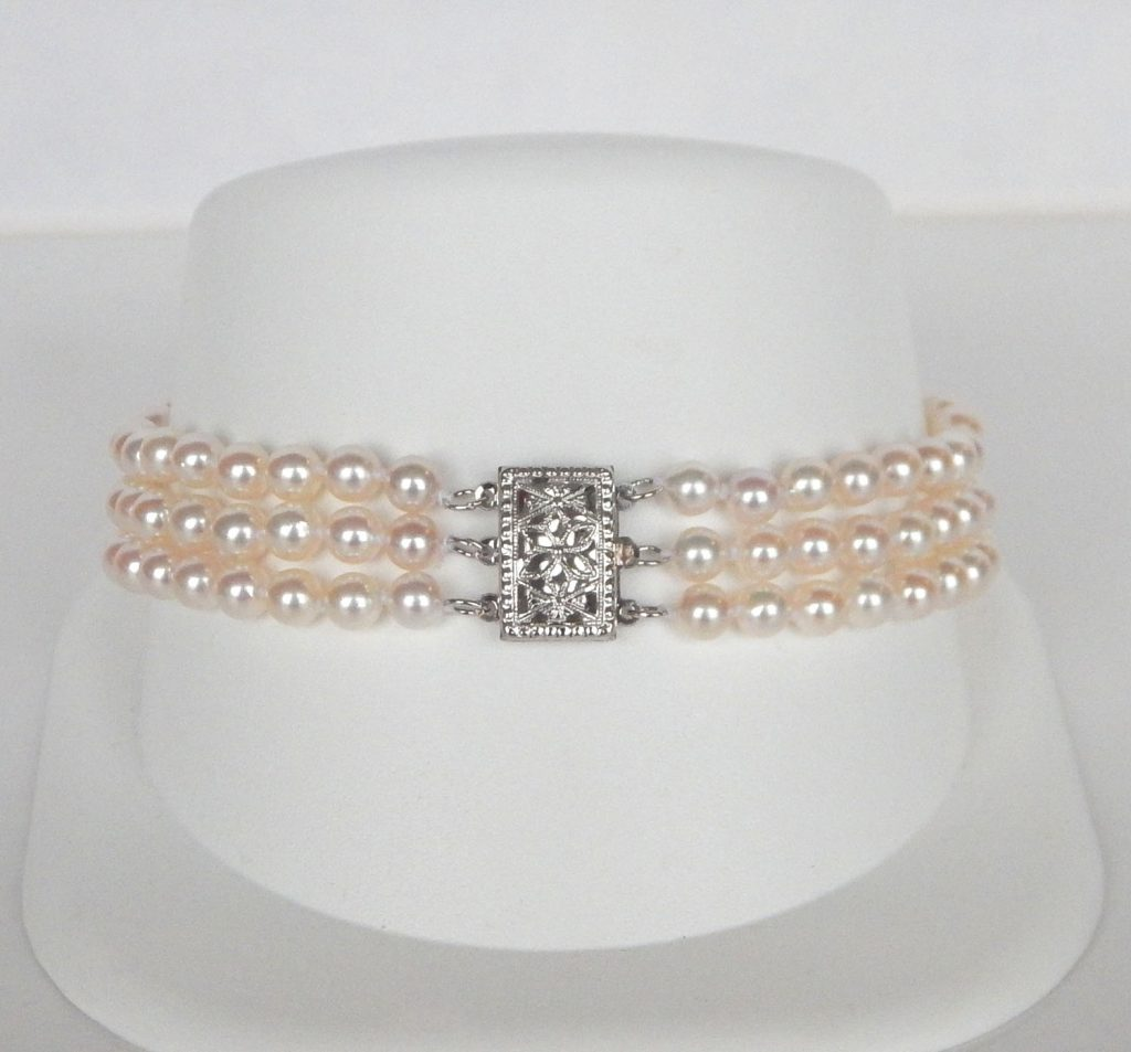 Three Strand Pearl Bracelet In White Gold