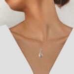 white gold diamond leaf pendant on model
