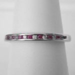 white gold ruby and diamond channel set band