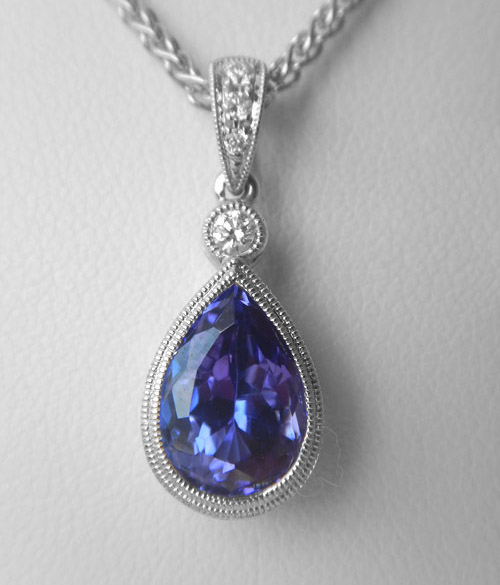 white gold pear shape tanzanite and diamond drop pendant