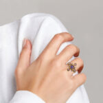 yellow gold amethyst and diamond ring on finger