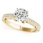 yellow gold diamond accented engagement ring with milgrain edges