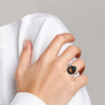 sterling silver cognac quartz ring on finger