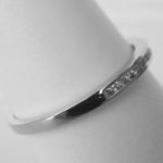 side view of white gold diamond channel set band
