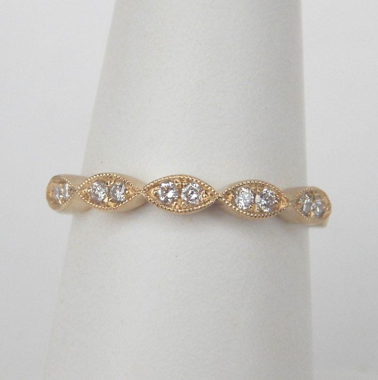 yellow gold diamond band with milgrain edges