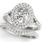 oval diamond halo engagement ring with matching wedding band