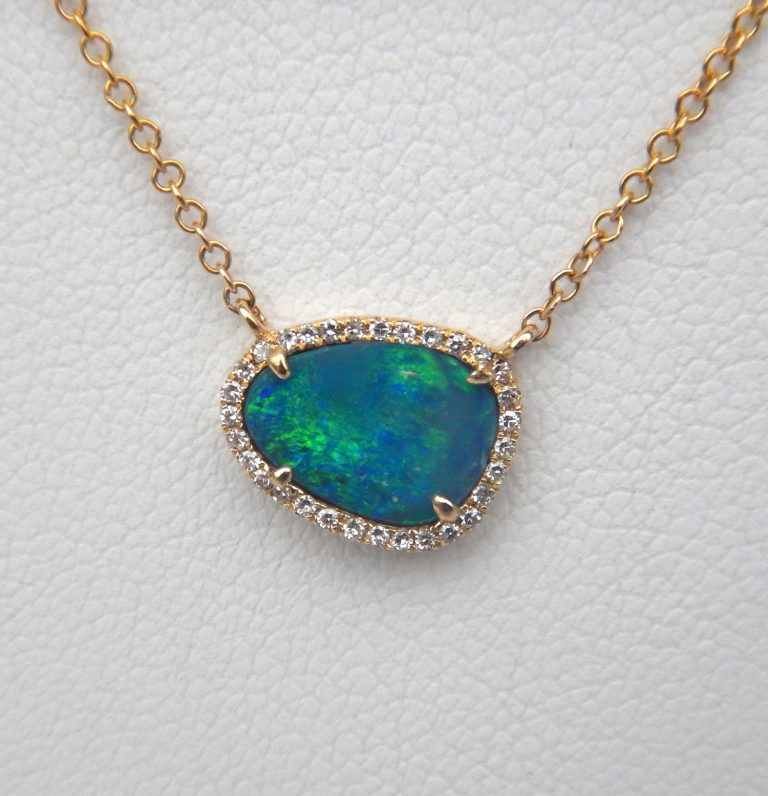 yellow gold black opal with diamond halo pendant