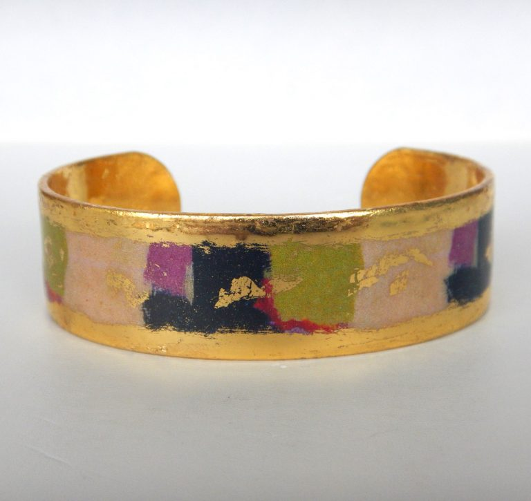 yellow gold cuff bracelet with green, black, and purple design