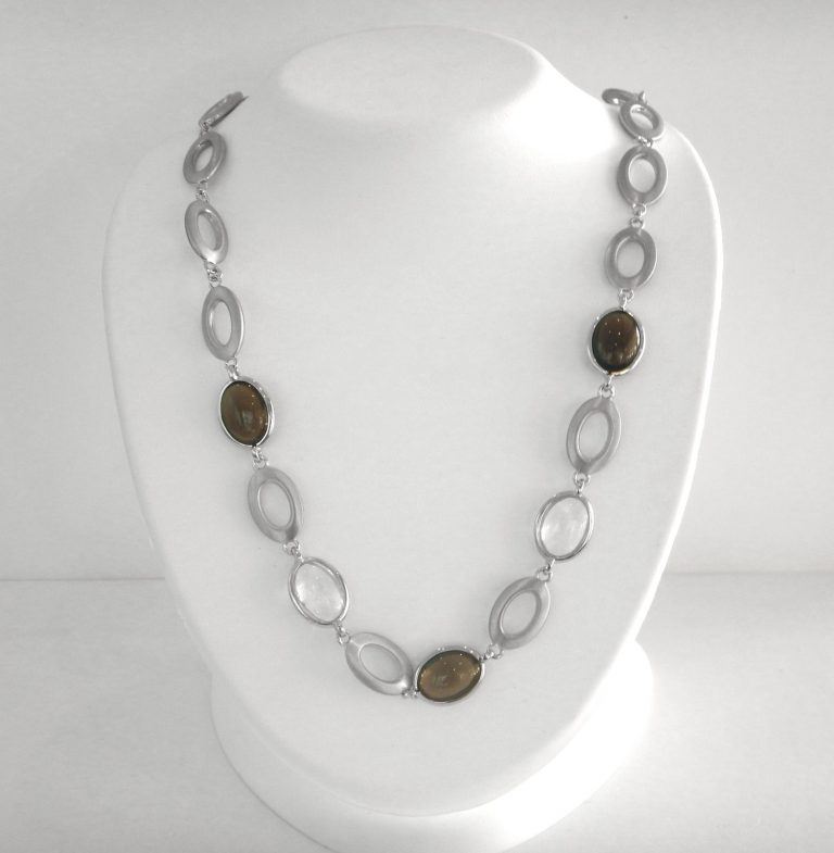 sterling silver necklace with clear quartz and smokey quartz gemstones connected by silver oval links
