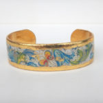 yellow gold cuff bracelet with floral pattern and butterflies