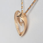 side view of yellow gold heart pendant