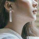 sterling silver dangle earrings on model