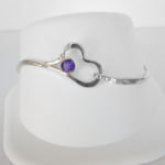sterling silver heart bangle with a round amethyst in the center