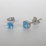 white gold blue topaz stud earrings