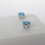 side view of blue topaz studs