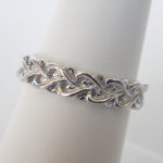 close up view of sterling silver intertwined hearts ring