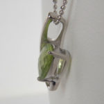 side view of peridot pendant