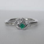 sterling silver claddagh ring with emerald heart in the center