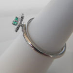 side view of sterling silver emerald claddagh ring