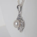 side view of sterling silver pearl and diamond pendant