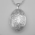 close up view of sterling silver swirl pattern locket