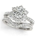 floral inspired engagement ring with matching wedding band
