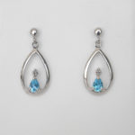 sterling silver blue topaz and diamond dangle earrings