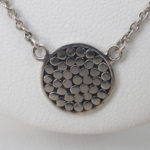 close up view of sterling silver necklace