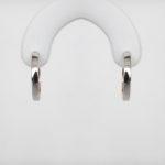 white and rose gold huggie hoop earrings