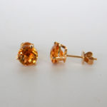 round citrine studs in yellow gold setting