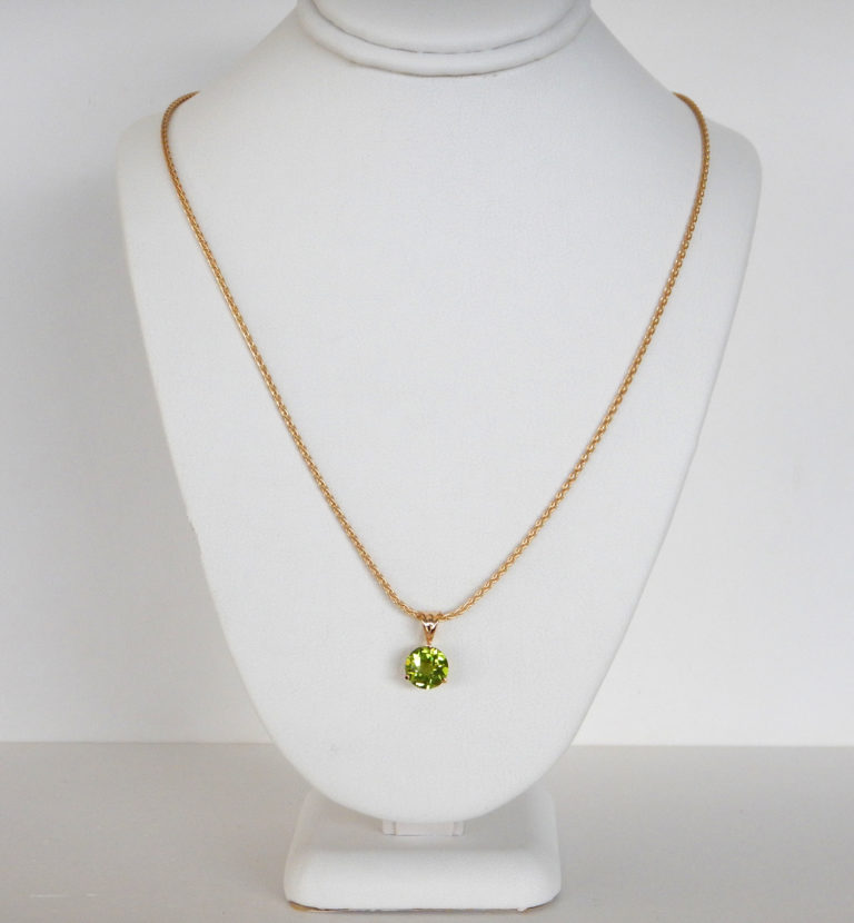 peridot pendant necklace in yellow gold