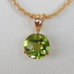 close up view of peridot pendant