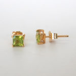 square peridot studs in yellow gold setting