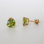 round peridot studs in yellow gold setting