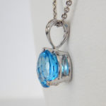 side view of blue topaz pendant
