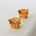 side view of yellow gold citrine studs