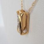 side view of yellow gold diamond pendant