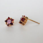 star garnet studs yellow gold