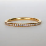 yellow gold bead set diamond band