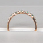 side view of emerald and diamond band