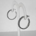 side view of sterling silver textured hoop earrings